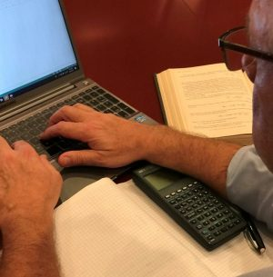 R. Lee Comer at work on computer